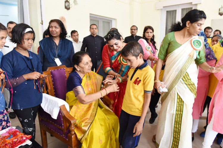 governor anandiben patel tied rakhi to children