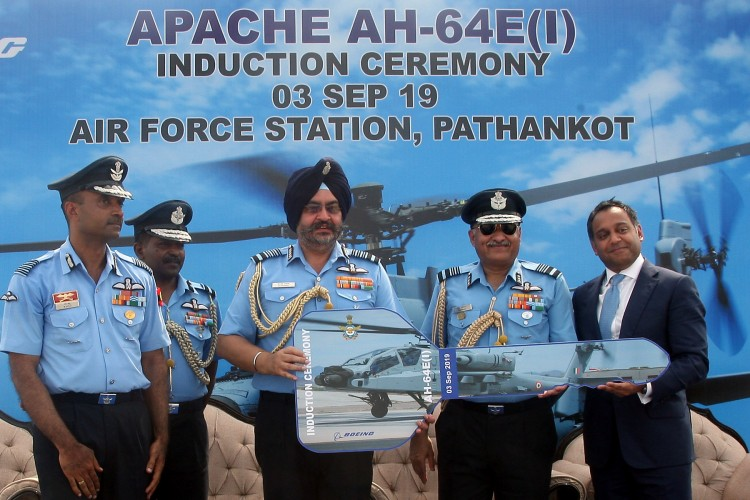 b.s. dhanoa at the induction ceremony of indian air force ah-64e apache attack helicopters