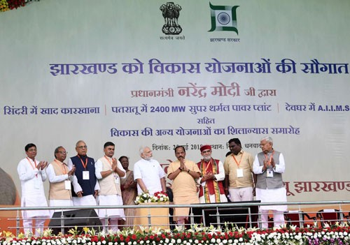 narendra modi laying the foundation stone of several development projects