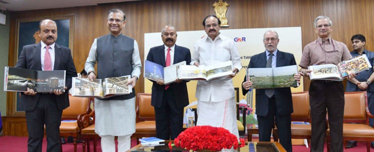 venkaiah naidu releasing the coffee table book of delhi airport