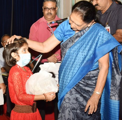 governor adopts tb girl child