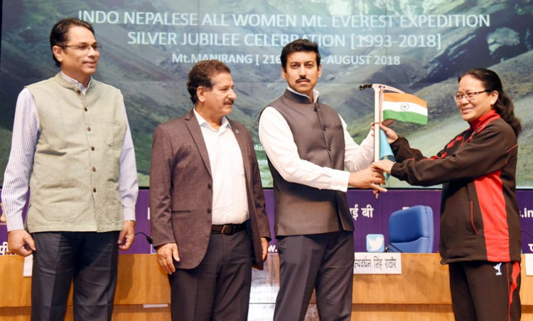 col. rajyavardhan singh rathore handing over the flags to bimla negi