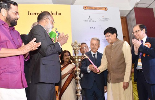piyush goyal lighting the lamp at the inauguration of the india tourism mart