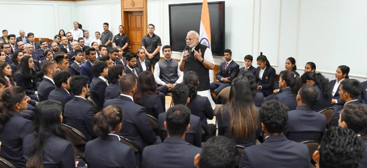 prime minister narendra modi medal while talking to the winners