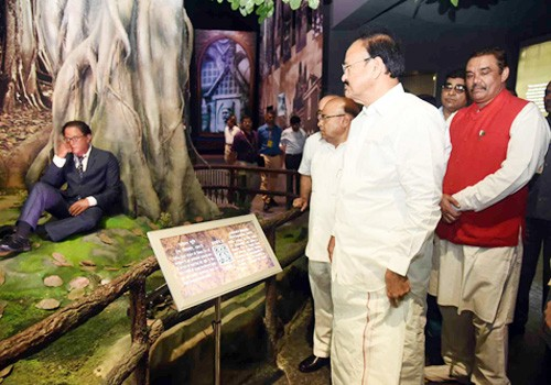 venkaiah naidu looking at the life-size statue of dr. b.r. ambedkar