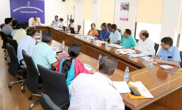 hrd minister held meeting with officials of education institute
