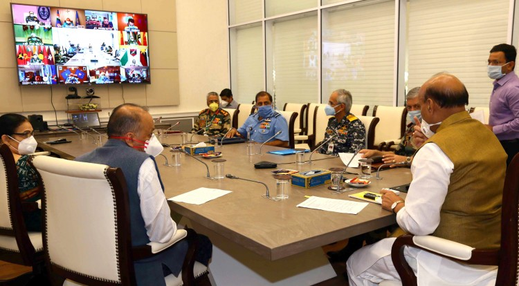 rajnath singh reviewing the undertaken to fight covid-19 with the various commanders in chief
