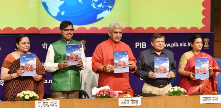 manoj sinha releasing a publication on the occasion of the world post day