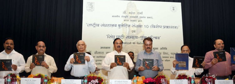 minister of state for culture dr. mahesh sharma releasing a book